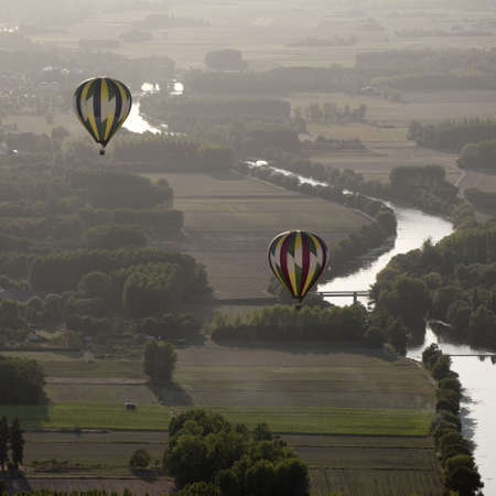 Hot air balloons over the river Cher in France photo