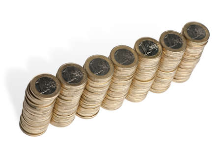 Stacks of 1 Euros Coins in front of white background, high angle view photo