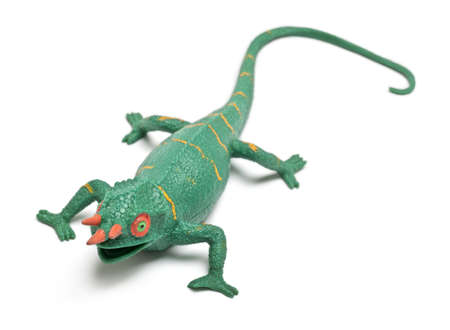 Chameleon toy in front of white background photo