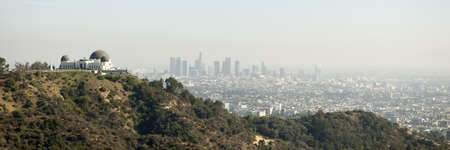 Skyline of Los Angeles with the Griffith observatory in the foreground, California, USA photo