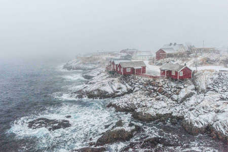 Hamnoy, Norway, fishing village on Lofoten Islands during a snow storm
