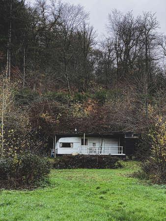 Old Abandoned caravan left in a camping close to the river Semois, Belgium