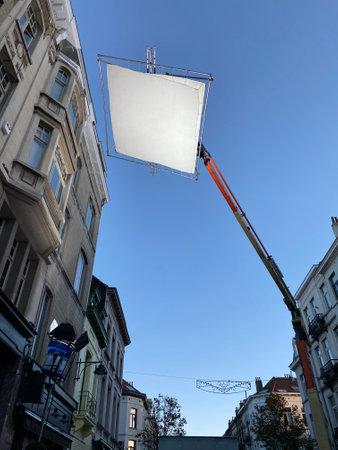 Shooting production, Process of filming. Spotlight illuminates large reflector