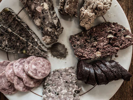 Top view on a french charcuterie assortment, sausage, rillettes, blood sausage
