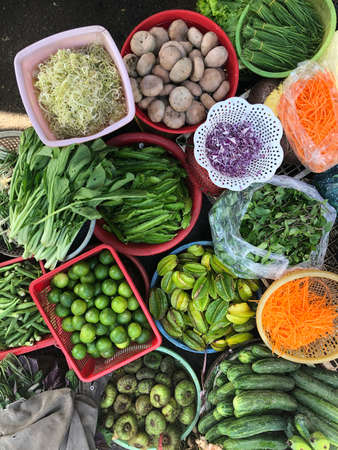 Top view on a large assortment of row loose vegetables and fruits for sale in a street. Short circuit production at Hue Market 版權商用圖片 - 160828916