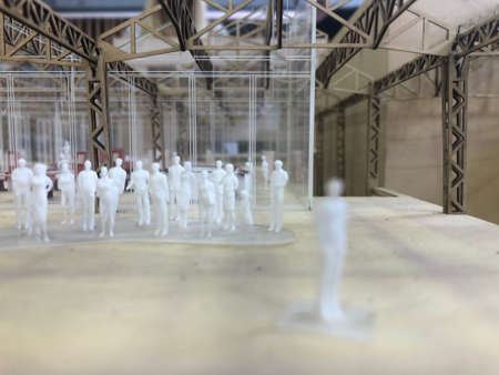 Architecture mockup of a huge workplace with miniature people inside