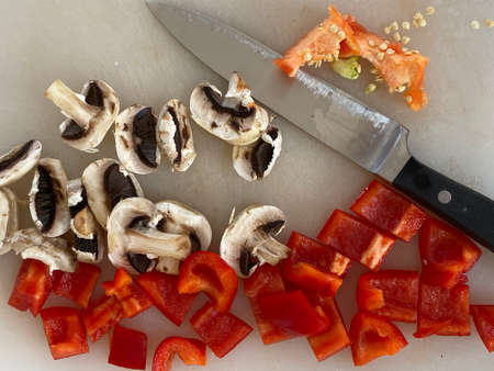 Red Peppers and mushrooms cutted on the desk in a kitchen