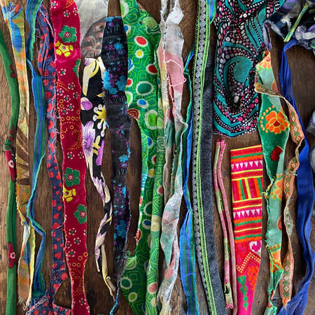Assortment of many colorful pieces of torn cloth 版權商用圖片