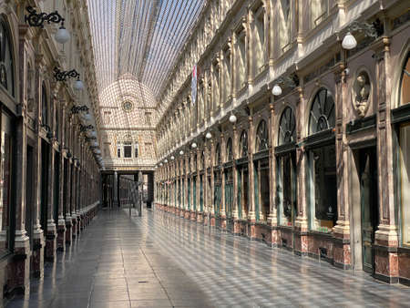 Brussels, Belgium, April 25, 2020 - inside the empty luxury glazed shopping arcade Les Galeries Royales Saint-Hubert during the Confinement covid-19, crisis