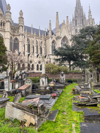 Brussels, Laeken, Belgium, November 30, 2020 - Destroyed or abandoned Graves at Laeken old Cemetery in Brussels, with the basilica of Laeken in the background