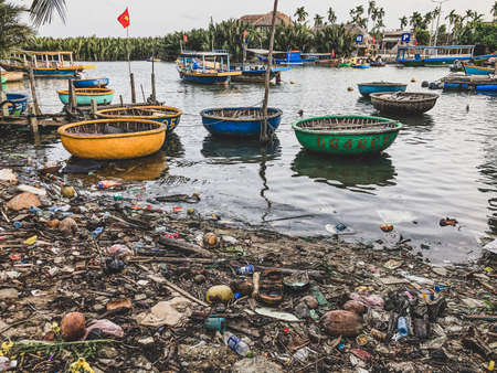 Hoi An, Vietnam, January 27, 2020 - Pollution near the Basket Boat ready to  touristic attraction