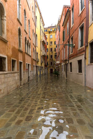 Venice, Italy - November 1, 2018: acqua alta, view on a street has been flooded by waters rising 156 cm