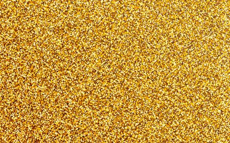 golden texture: golden glitter background. Luxury shimmering golden texture.