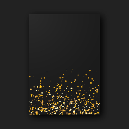 Black paper poster sheet with shiny glam golden glitter sparks on black background.