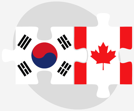 asian business team: South Korea and Canada Flags in puzzle isolated on white background