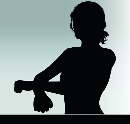 handcuffed: woman silhouette with handcuffed hand gesture