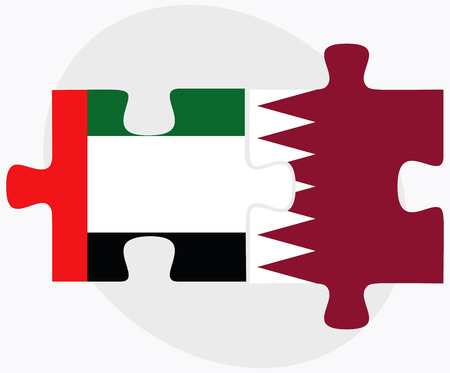 doha: United Arab Emirates and Qatar Flags in puzzle isolated on white background