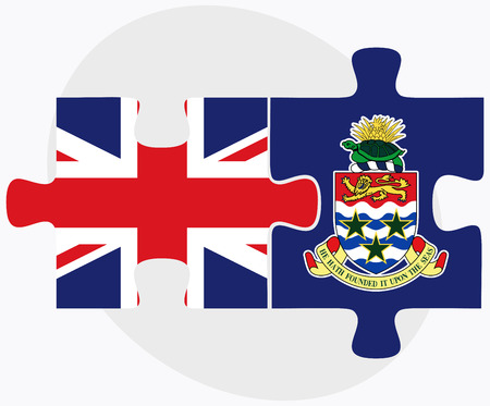 cayman islands: United Kingdom and Cayman Islands Flags in puzzle isolated on white background