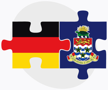 cayman islands: Germany and Cayman Islands Flags in puzzle isolated on white background