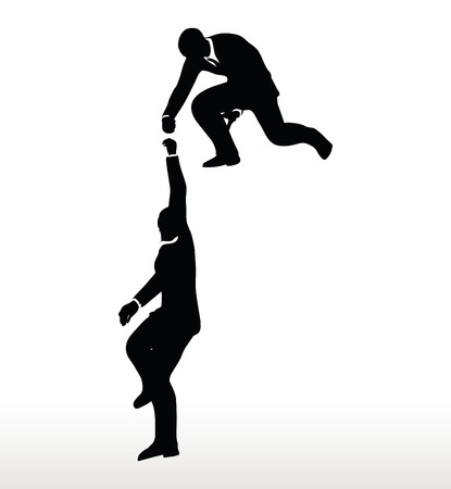 climbing mountain: silhouette of two businessmen team holding on with a helping hand