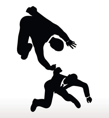reach out: silhouette of two businessmen team holding on with a helping hand