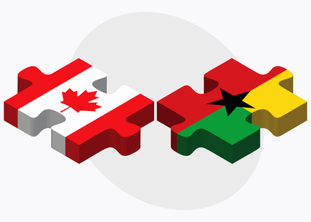 georgetown: Canada and Guyana Flags in puzzle isolated on white background