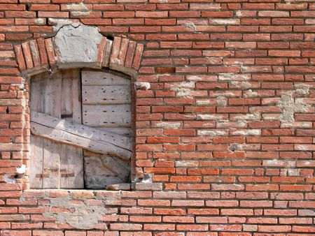 architrave: Close up of an old closed window in a classic red old wall