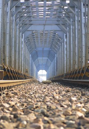 Picture of a railway bridge whit long perspective and a particular light at the end of the tunnel photo