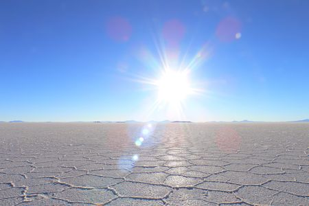 salar de uyuni: Horizon of salt desert and sunny blue sky Stock Photo