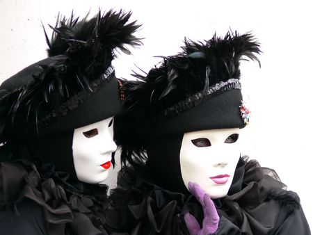 Close-up of 2 venica black masks with purple and red lips photo