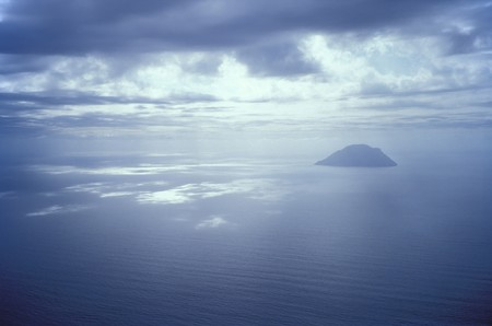 alicudi: Picture of Alicudi island toked from Filicudi island with cloudy sky