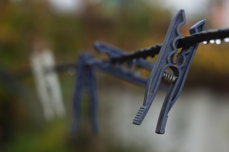 natural drying: Clothespins on a black rope.Selective focus. Stock Photo