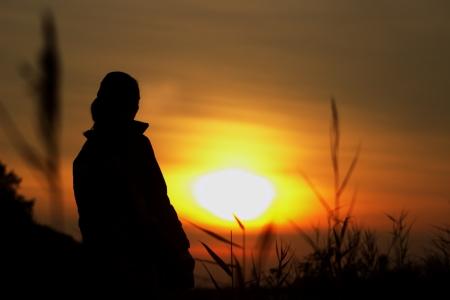 Woman Praising And Enjoying Golden Sunset Stock Photo