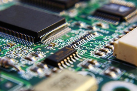 Printed Circuit Board with many electrical components. Banco de Imagens