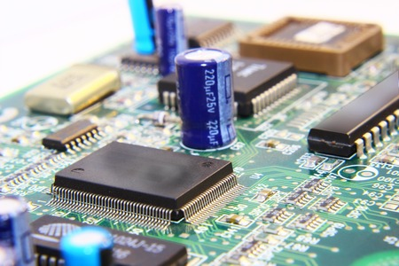 Printed Circuit Board with many electrical components. photo