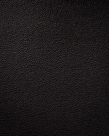 Vertical black leather texture. Synthetic material background in rough style.