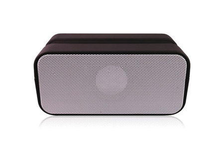 Portable wireless speaker isolated on white background. Black loudspeaker for playing music. Clipping paths object.
