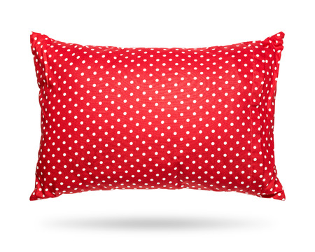 Blank pillow isolated on white background. Red cushion in polka dots pattern concept. Clipping paths object.