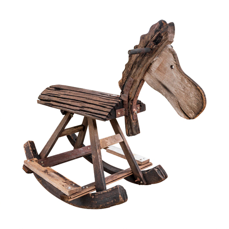 Retro rocking horse made from wooden isolated on white background. Wooden chair for children can be riding. ( Clipping path ) Standard-Bild