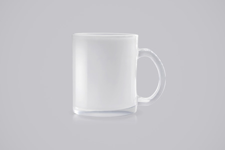 Transparent mug on grey background. Clear drink cup for your design.