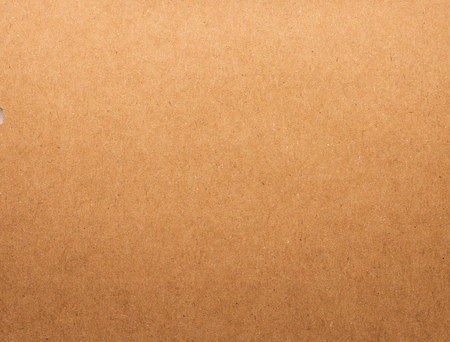 Cardboard texture background. Brown paper material. Blank paperboard.
