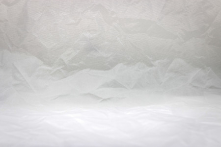 Crumpled fabric texture background. Wrinkled cloth material.