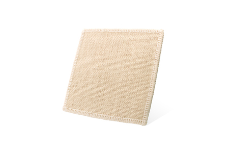 Square coaster on isolated background with clipping path. Fabric pad for put your mug or cup.