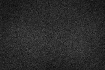 Fondo nero di struttura della schiuma. Struttura in gomma vuota. Archivio Fotografico
