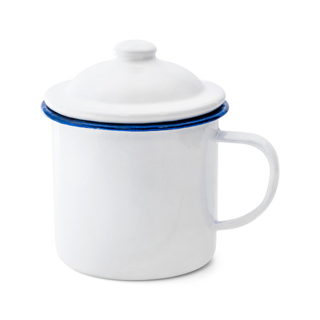 Blank enamel mug isolated on white background. Vintage cup made from tin material. ( Clipping path )