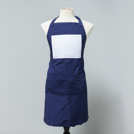 Blue canvas apron uniform on mannequin for designer. Housewife costume for cooking or cleaner. Standard-Bild