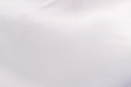 Fondo de textura de terciopelo blanco brillante.