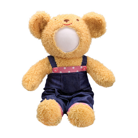Teddy bears doll isolated on white background. Bear's doll in blue jeans uniform. Blank face toy for design. Reklamní fotografie