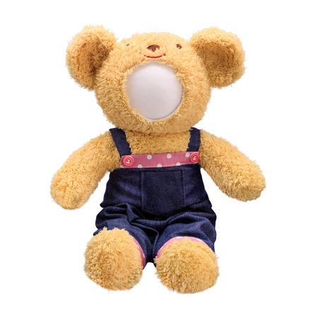 Teddybär-Puppe isoliert auf weißem Hintergrund. Bärenpuppe in blauer Jeansuniform. Leeres Gesichtsspielzeug für Design. Standard-Bild