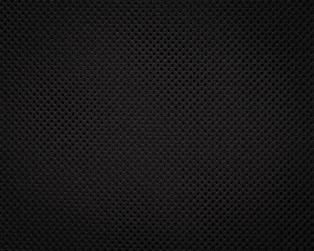 Black fabric texture. Dark textile pattern background. Detail of synthetic material. Фото со стока